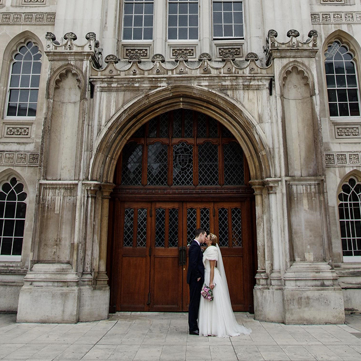 bride and groom kissing outside Guildhall